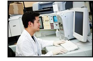 A shot of a laboratory technician working on a computer