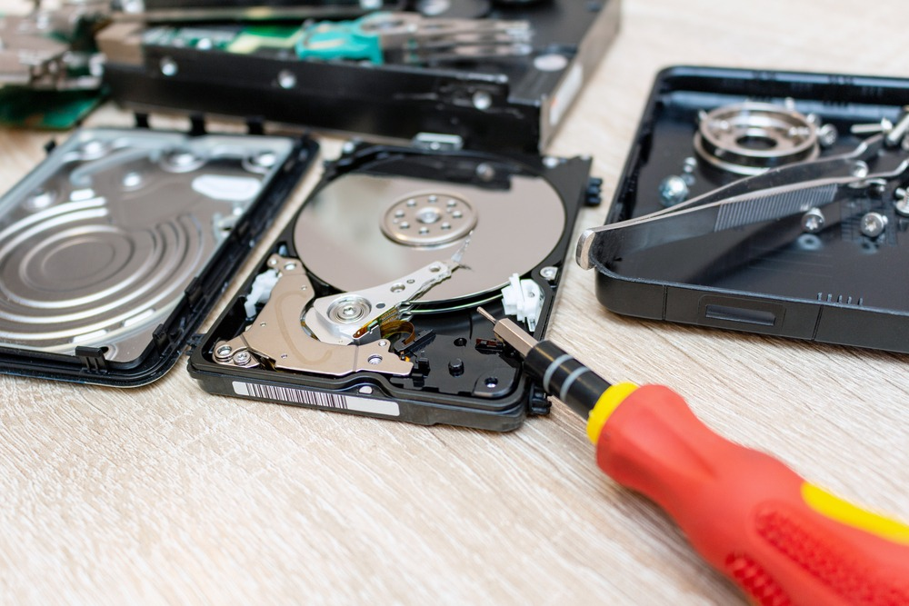 old broken hard disk drives composition in a repair recovery ser